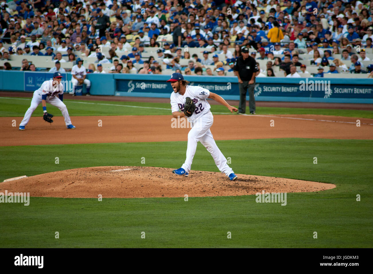 Dodger ace pitcher Clayton Kershaw reacts dramatically after striking out an opposing batter while pitching at Dodger - Stock Image