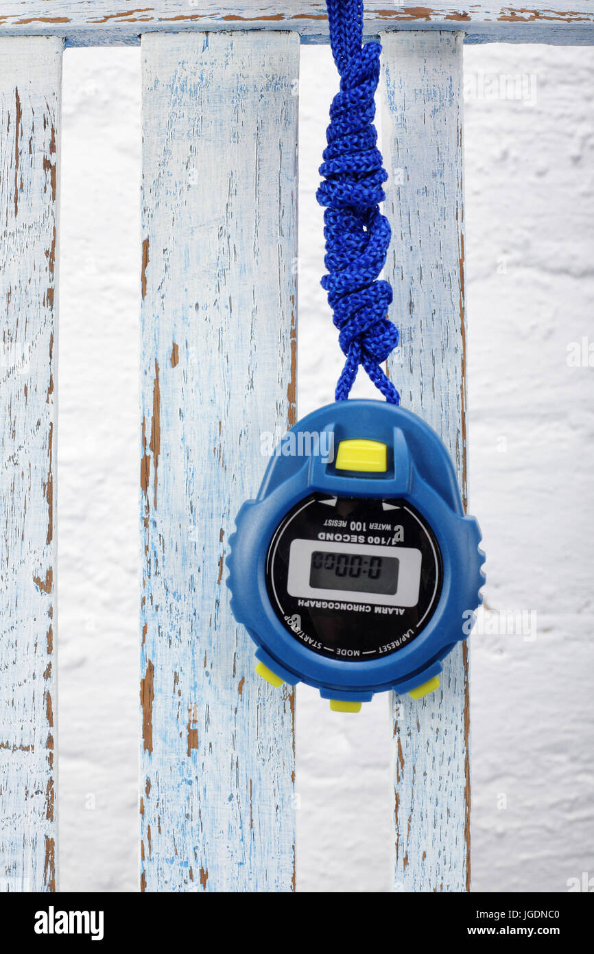 Sports equipment - Blue Digital electronic Stopwatch on a vintage wooden background - Stock Image