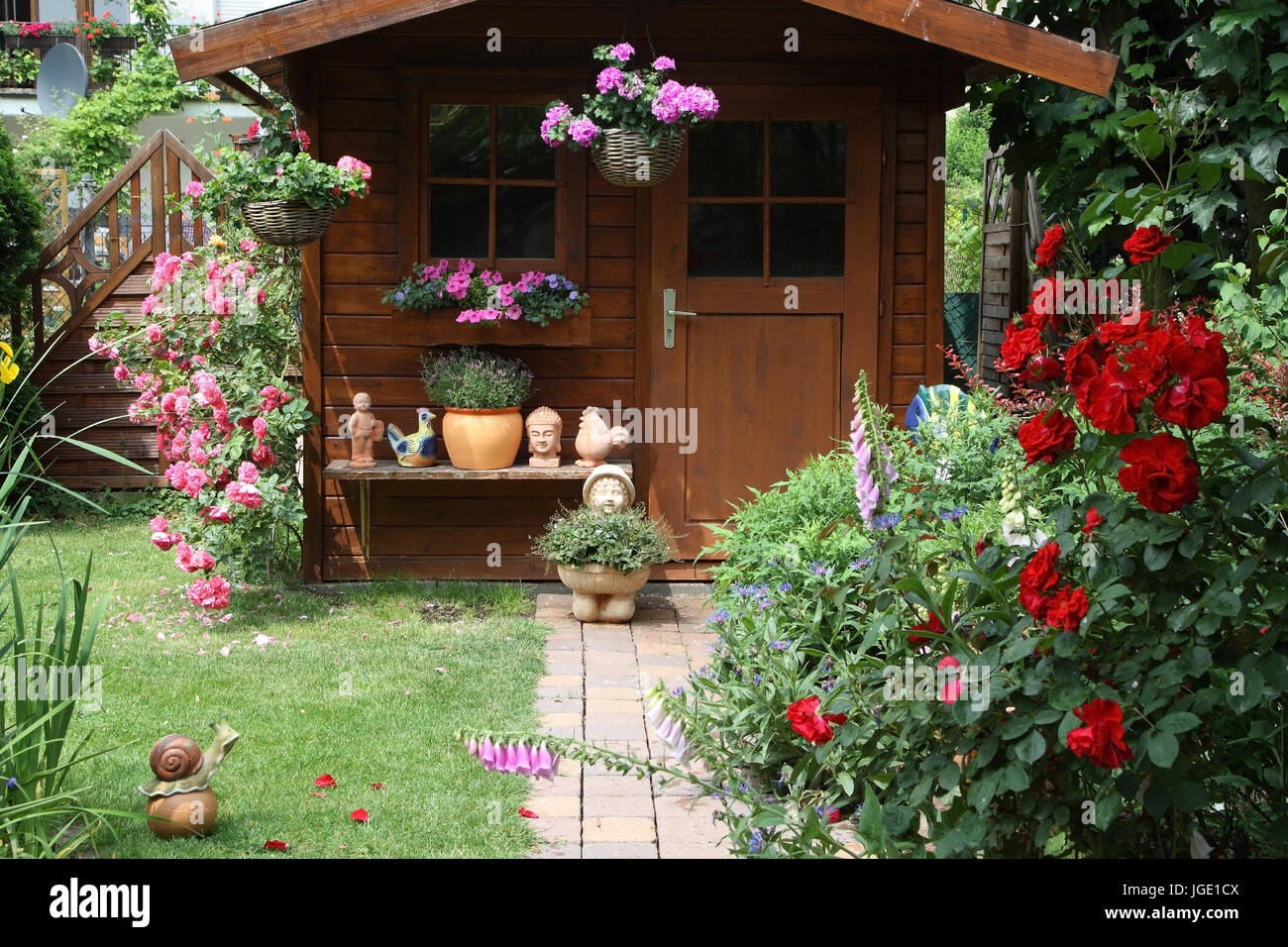 Summer House With Flowers And Garden Figures Stock Photos & Summer ...