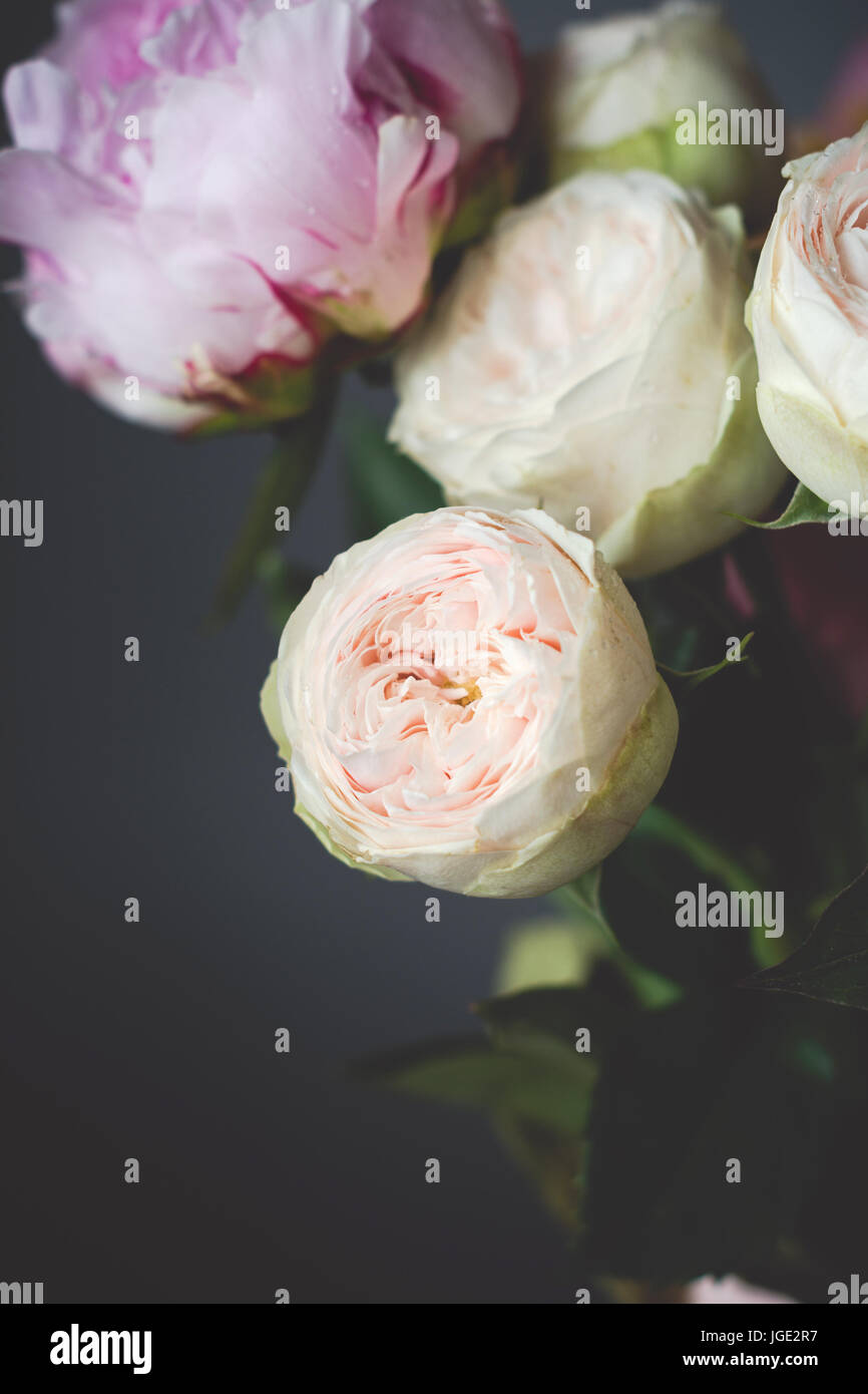 Peonies and roses bouquet. Shabby chic pastel colored wedding bouquet. Closeup view, selective focus - Stock Image