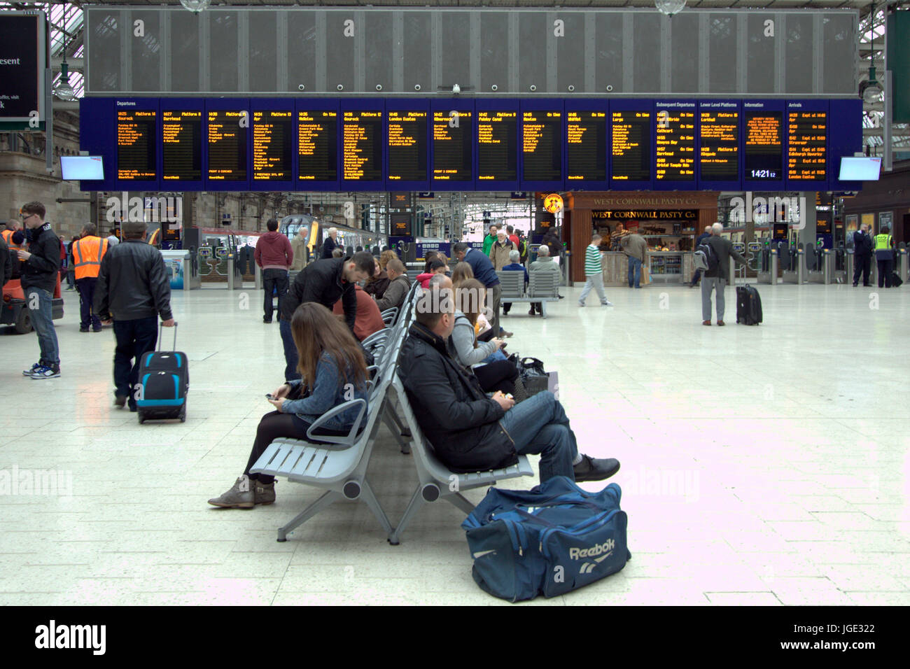 Central  railway Station Glasgow concourse with commuters and destinations board - Stock Image
