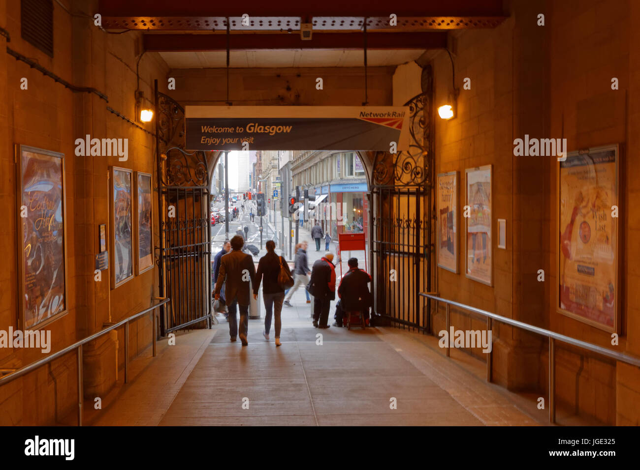 newspaper vendor entrance exit to Glasgow central  train railway station onto hope street - Stock Image