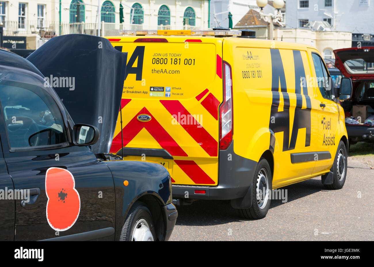 Broken down London Black cab with bonnet up and an AA van on scene. - Stock Image