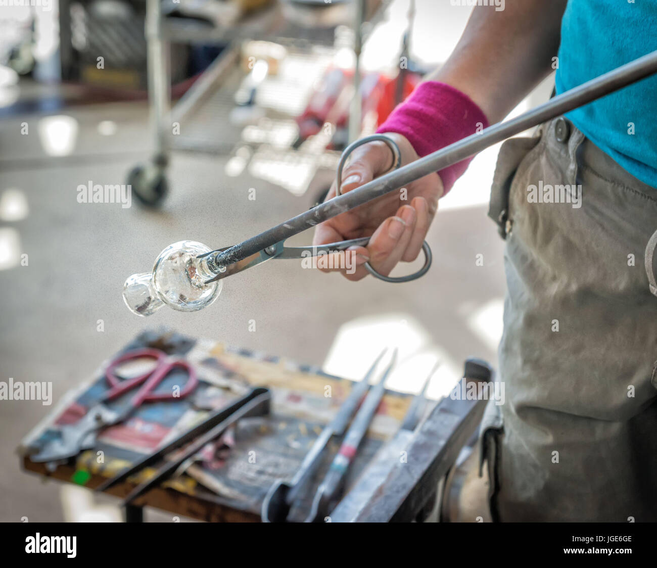 Glass blower working at an open market at Pikes Place Market, Seattle, Washington. - Stock Image