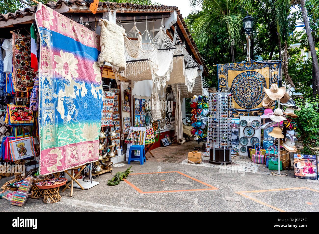 Outdoor market in Puerto Vallarta's Zona Romantica on the Rio Cuale with souvenirs, textiles, hammocks. - Stock Image