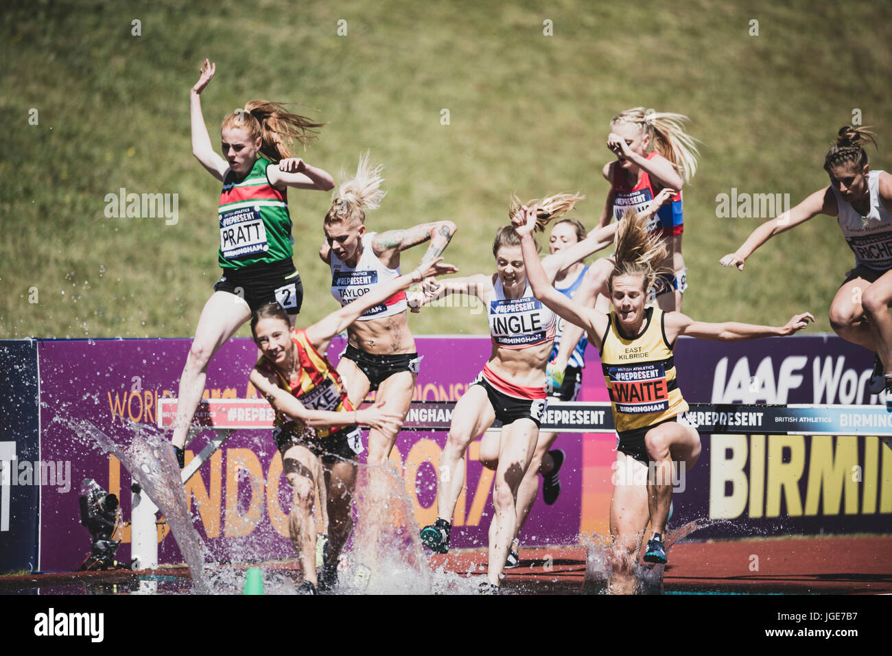 The women's steeplechase clears the water jump at the British Athletics Championships and World Trials at Birmingham, Stock Photo