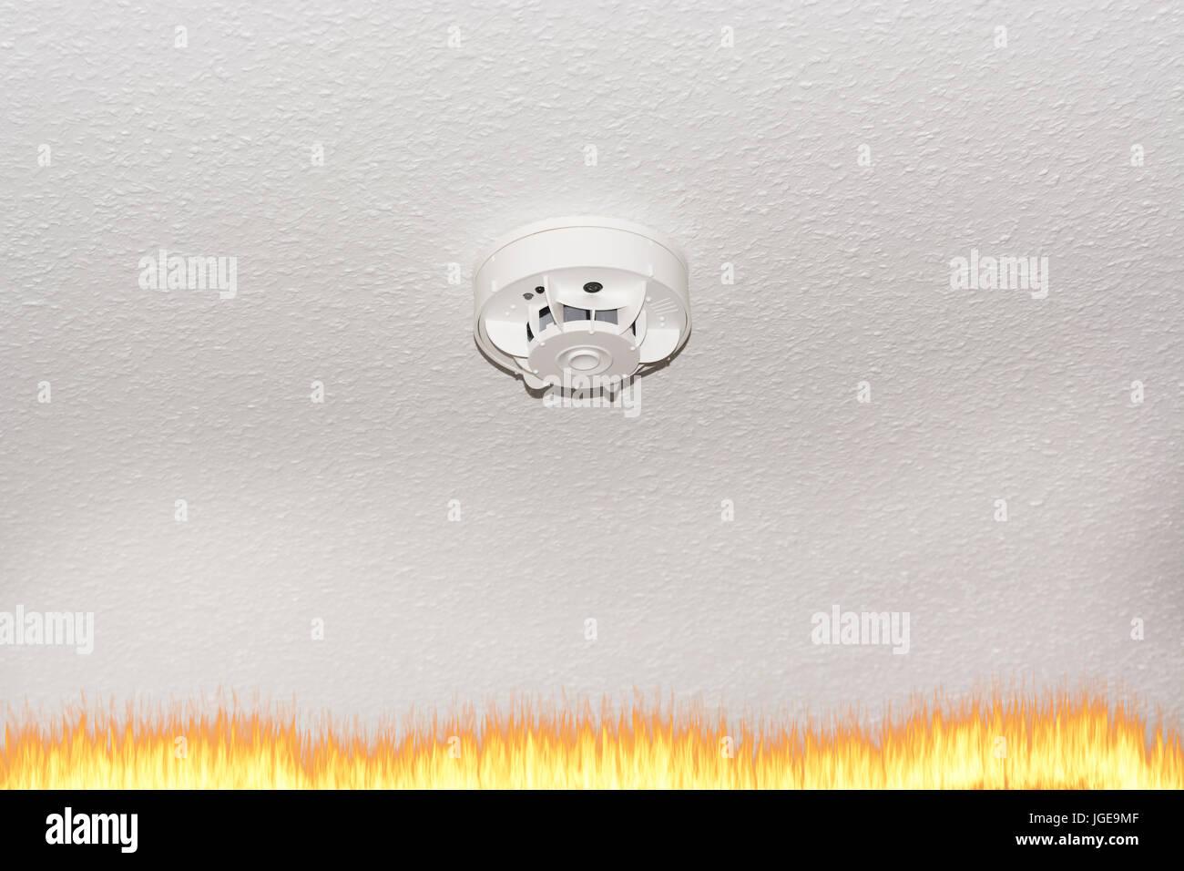 Smoke detector on the ceiling with red warning light sensor and smoke. - Stock Image