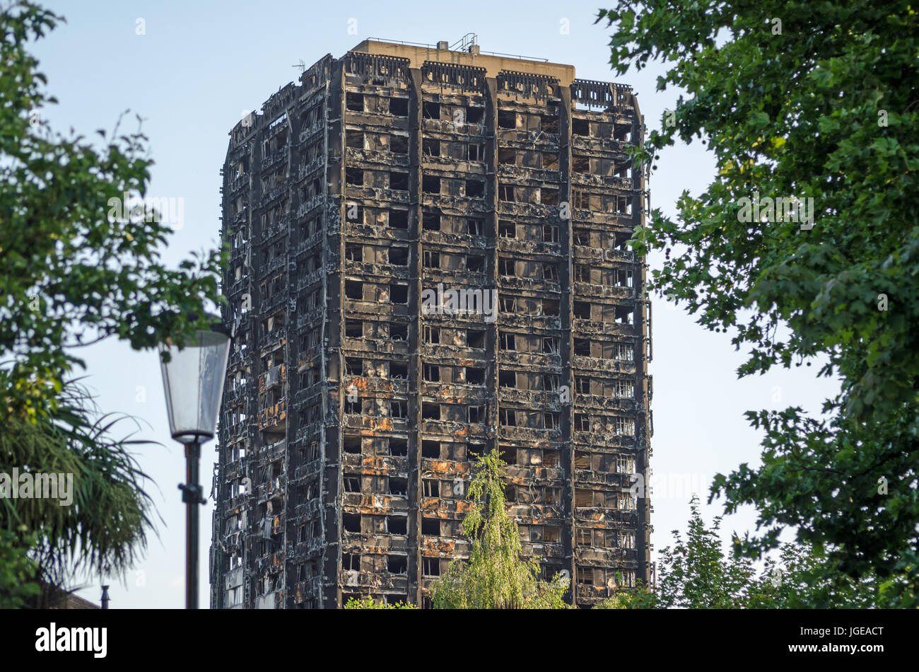 Charred remains of the Grenfell Tower block of council flats in which at least 80 people are feared to have died - Stock Image