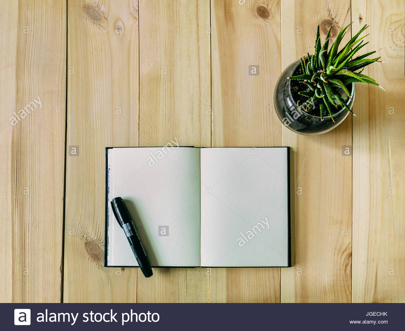Sketch Book On The Table Open Sketch Book Is Lying On A Wooden Table