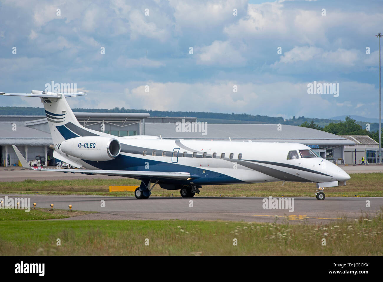 Ember ERJ 135 Legacy 600 Aircraft at Dalcross airport Inverness in the Scottish Highlands UK Stock Photo