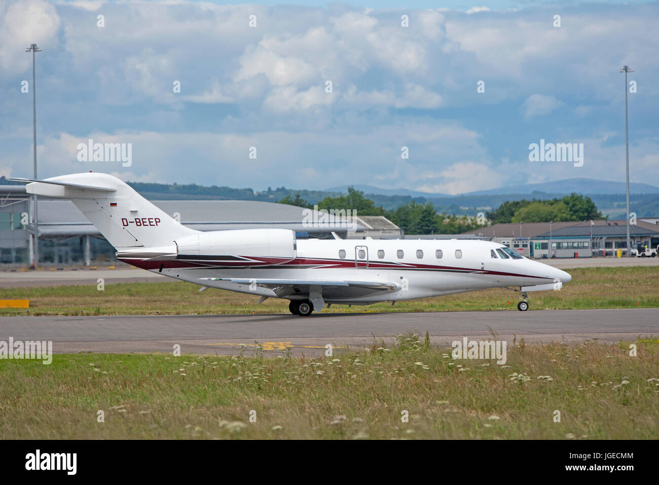 A German registered Cessna 750 Citation X on final approach to Inverness Airport in the Scottish Highlands North Stock Photo