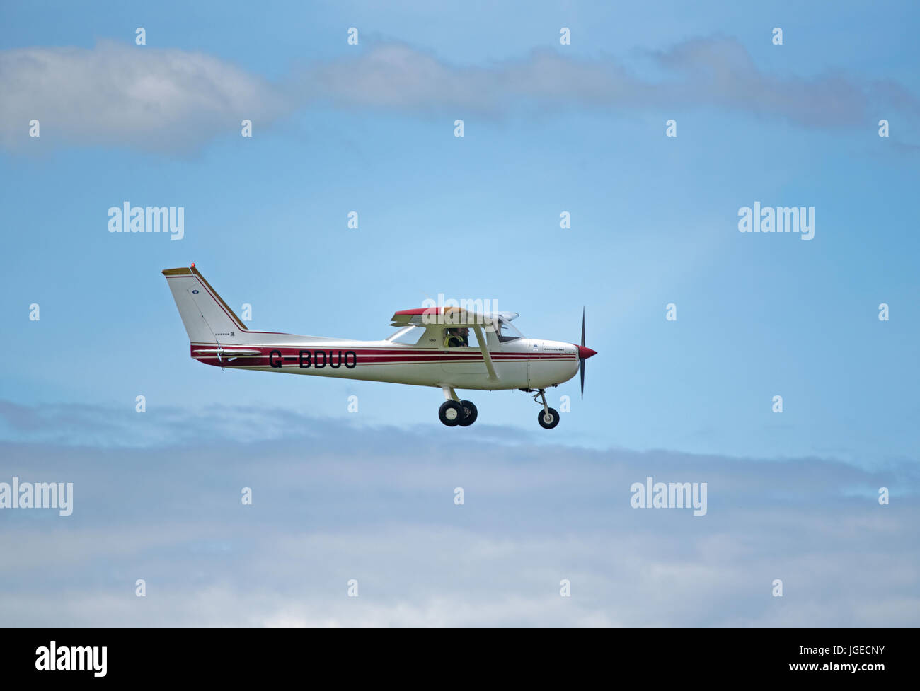 A Cessna 150m private light aircraft working out from Inverness Dalcross airport on a weekend flying sortie. Stock Photo