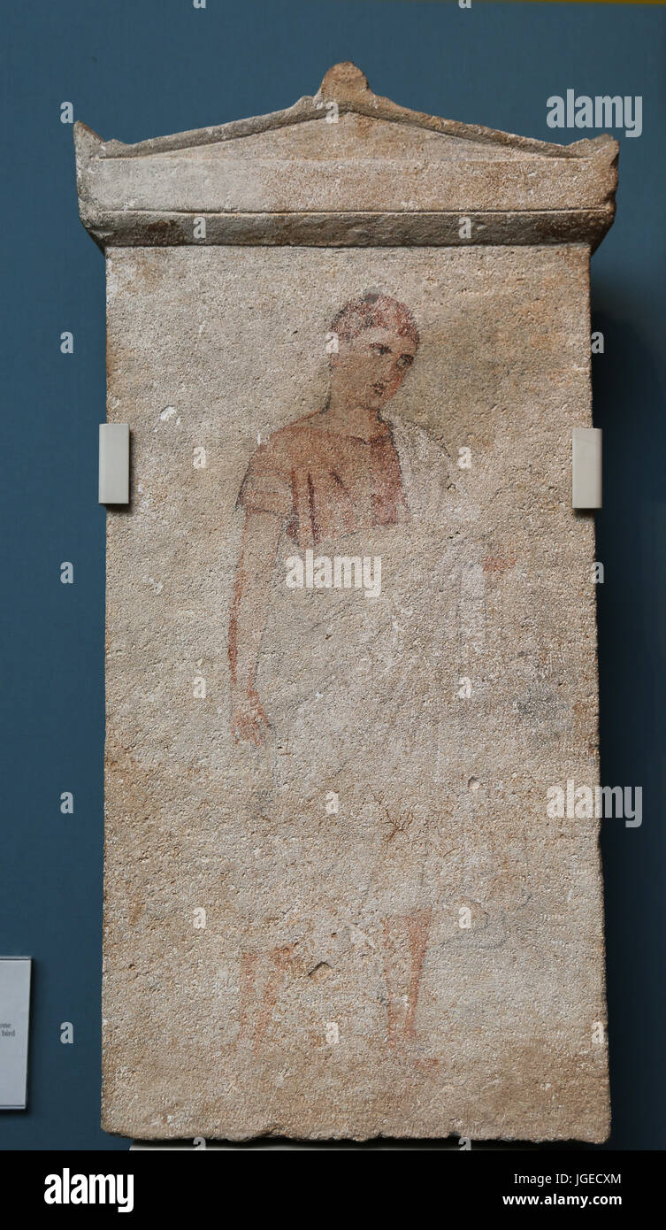 Limestone stelae with pediment tops. Probably from Amathus. 3rd-2nd century BC. Young boy holding a bird. British - Stock Image
