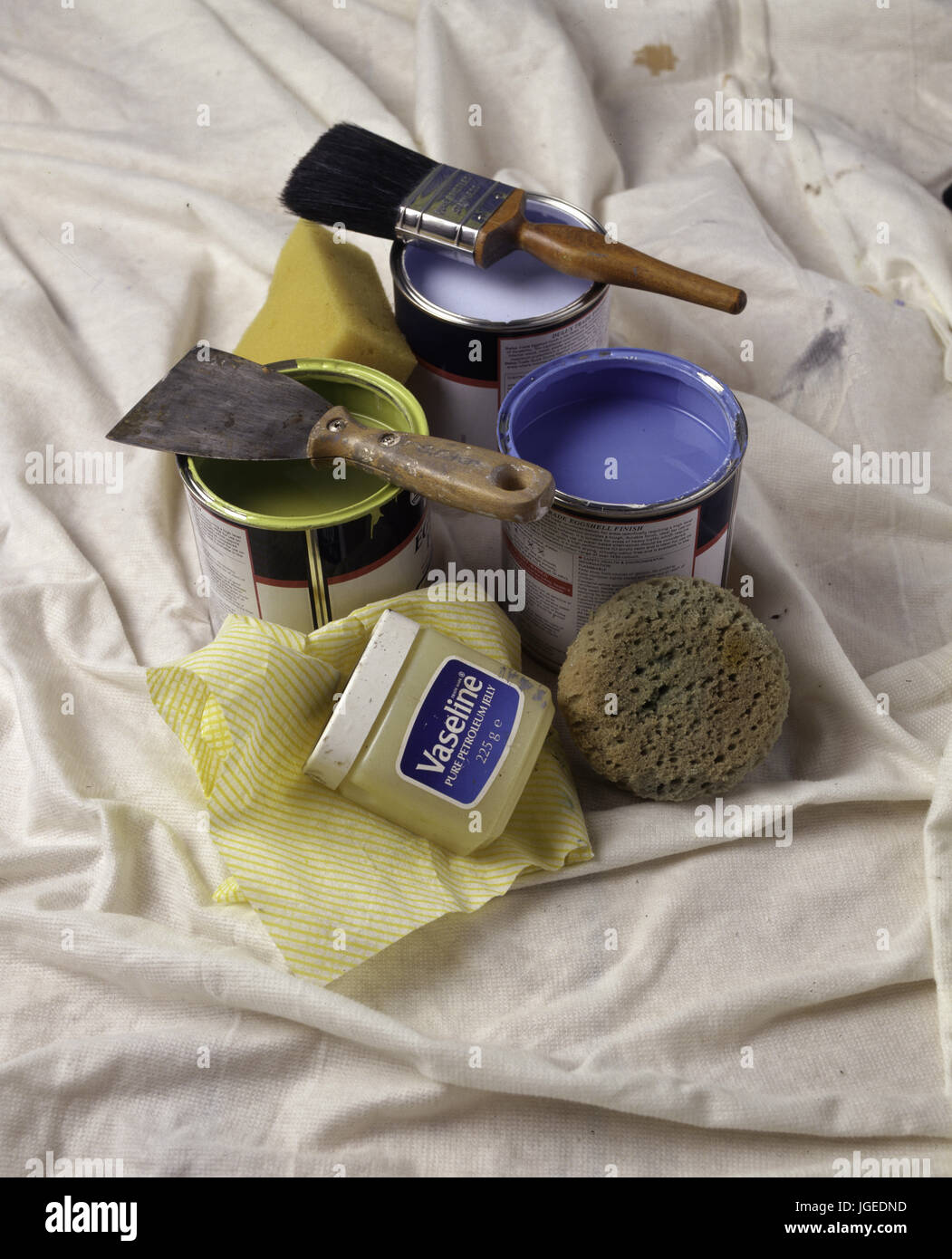 Tins of blue and green paint sith paint brushes Stock Photo