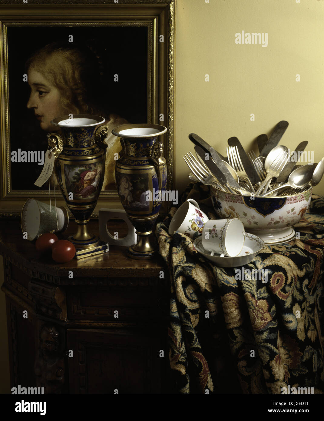 Closeup of cutlery, china and vases in saleroom lot - Stock Image