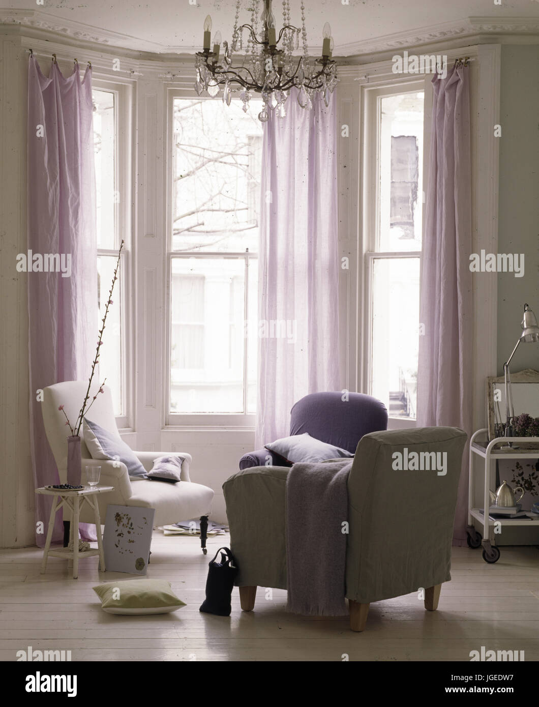 Bay Window With Sheer Mauve Curtains In Contemporary Decorated Stock Photo Alamy