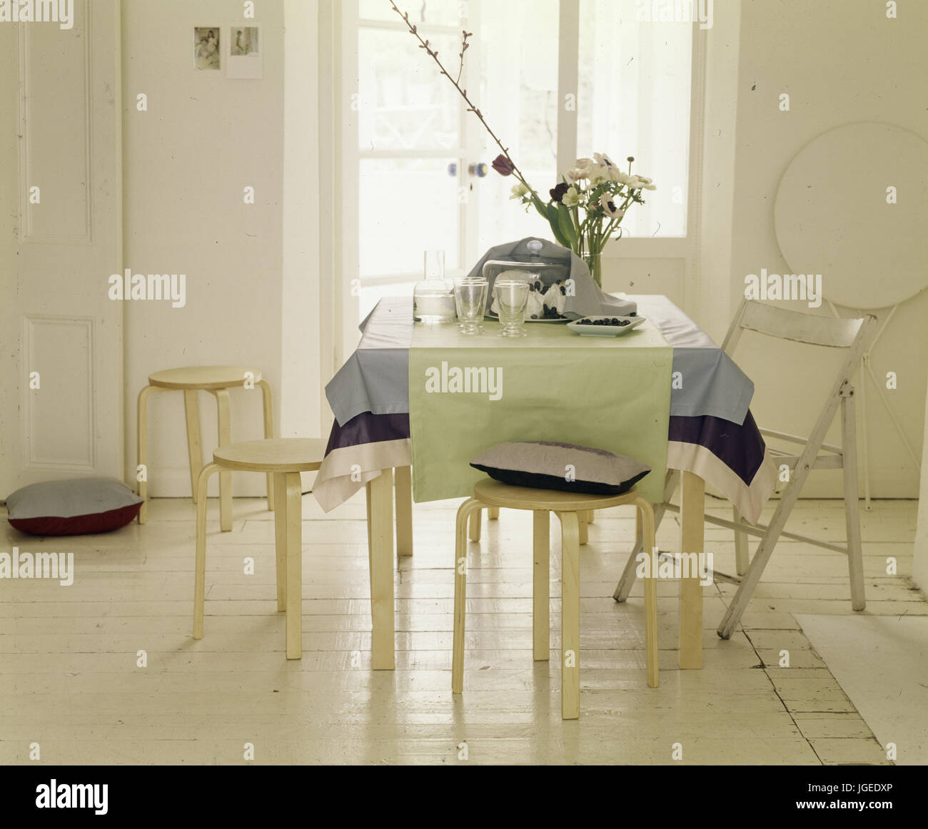 Contemporary decoration of dining room in traditional flat with white painted floorboards Stock Photo