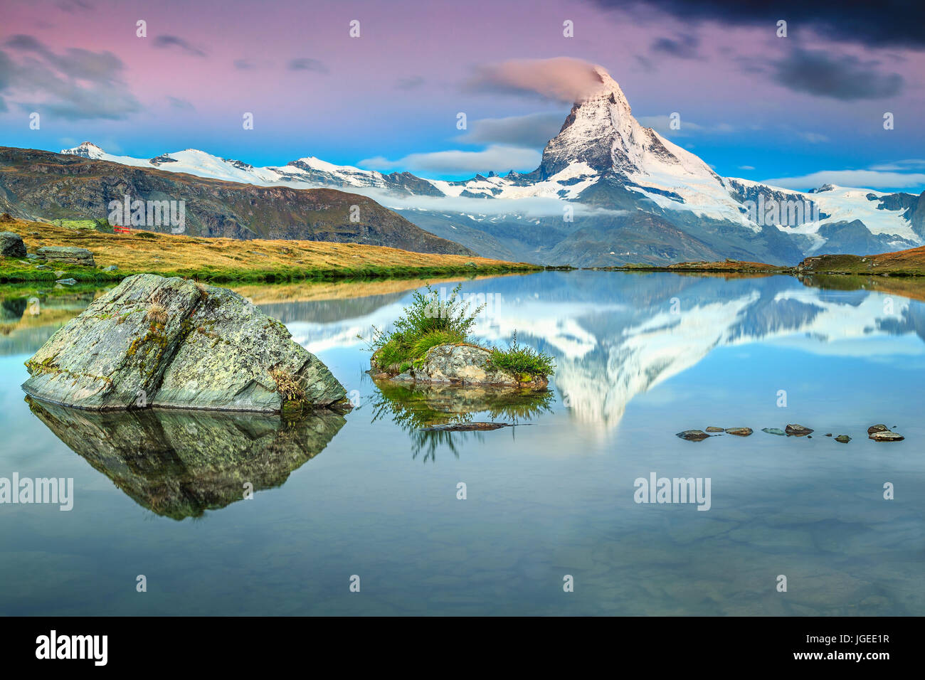 Fantastic sunrise panorama with Matterhorn and beautiful famous alpine lake, Stellisee, Valais region, Switzerland, - Stock Image