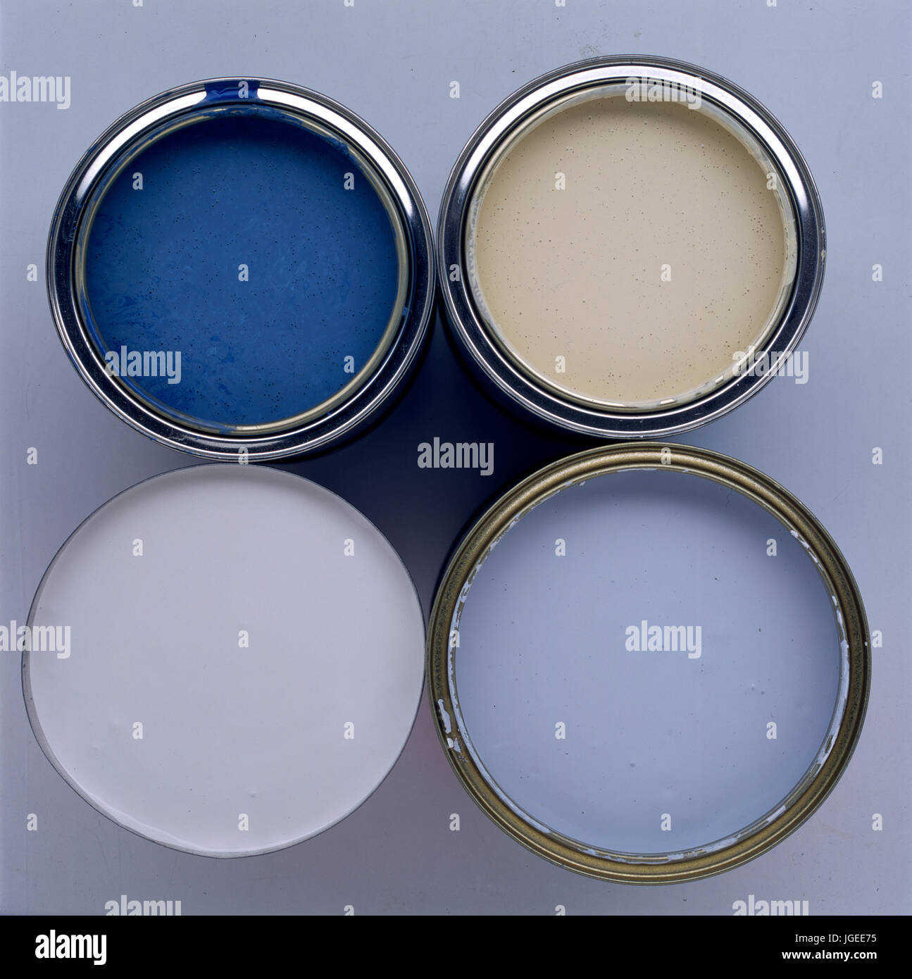 Close-up of tins of paint. Step x step decorating. - Stock Image