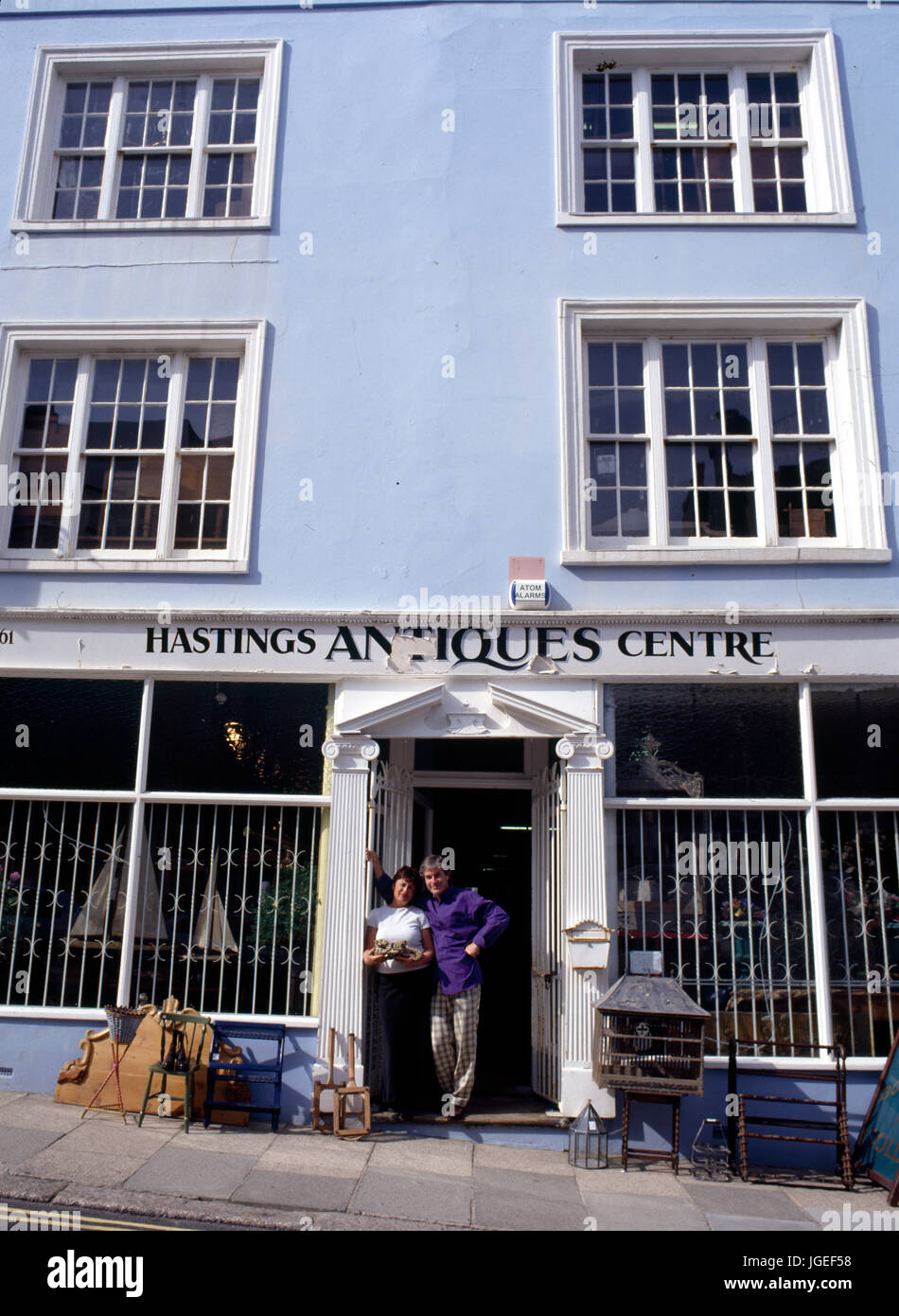 Owners outside their antiques shop in Hastings, US - Stock Image