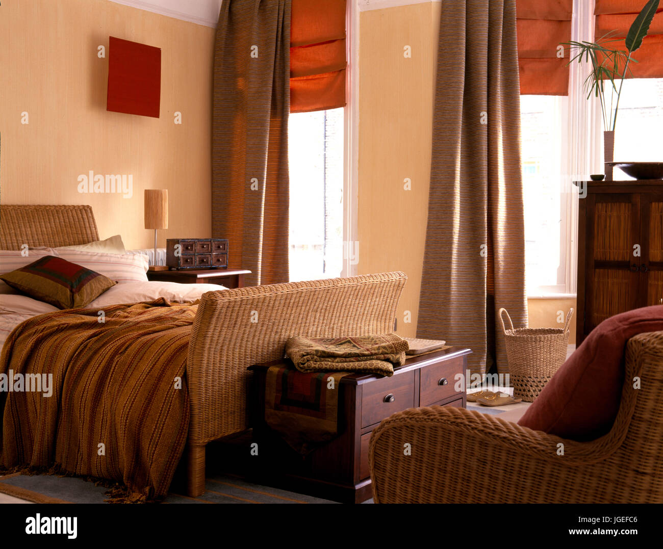 drapes and blinds interior design wicker bed in bedroom with orange blinds and brown drapes stock image drapes and blinds photos images alamy