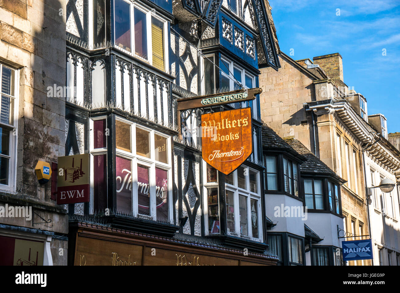 Sign for Walkers Books and Thorntons, outside period buildings in historic Stamford town, Lincolnshire, England, - Stock Image