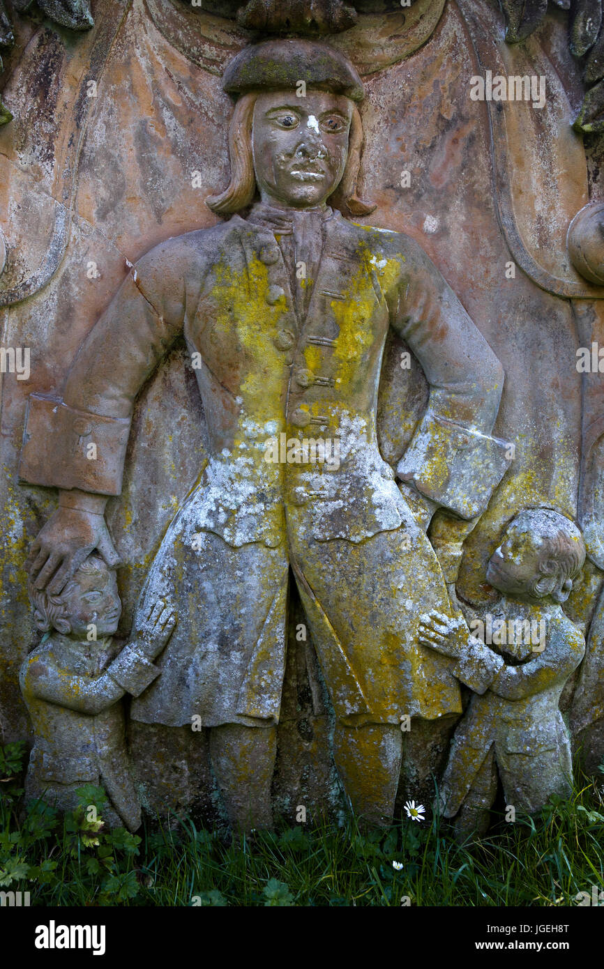 View of reverse face of gravestone of John Craig, d. 1742, showing relief portrait with children, Old Temple Kirk, - Stock Image