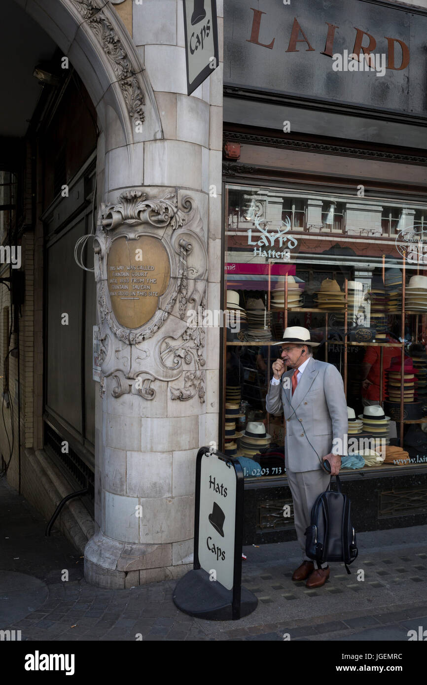 A foreign-looking gentleman stands talking into his phone's hands-free outside Laird Hatters, on 5th July 2017, - Stock Image