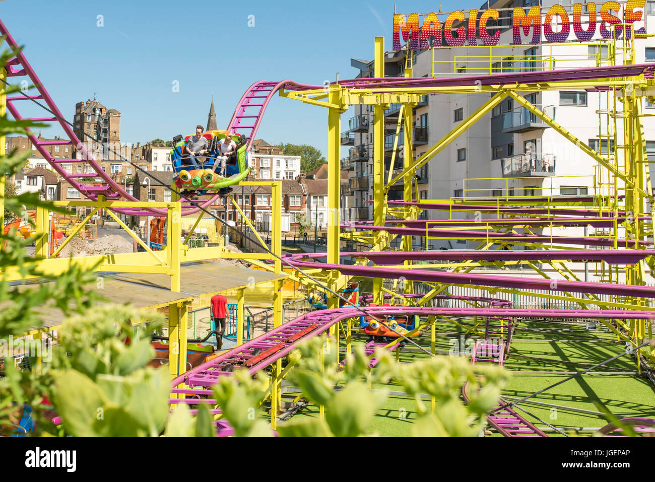 People enjoying the Magic Mouse ride at the recently re-opened, Dreamland Pleasure Park, Margate, Kent. - Stock Image