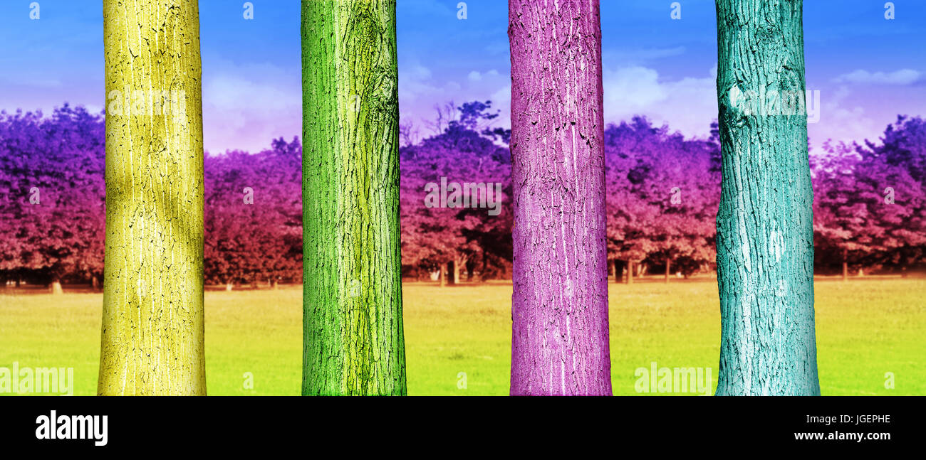 Colorfull Tree Trunks in the Park. Abstract Psychedelic Colors Stock Photo