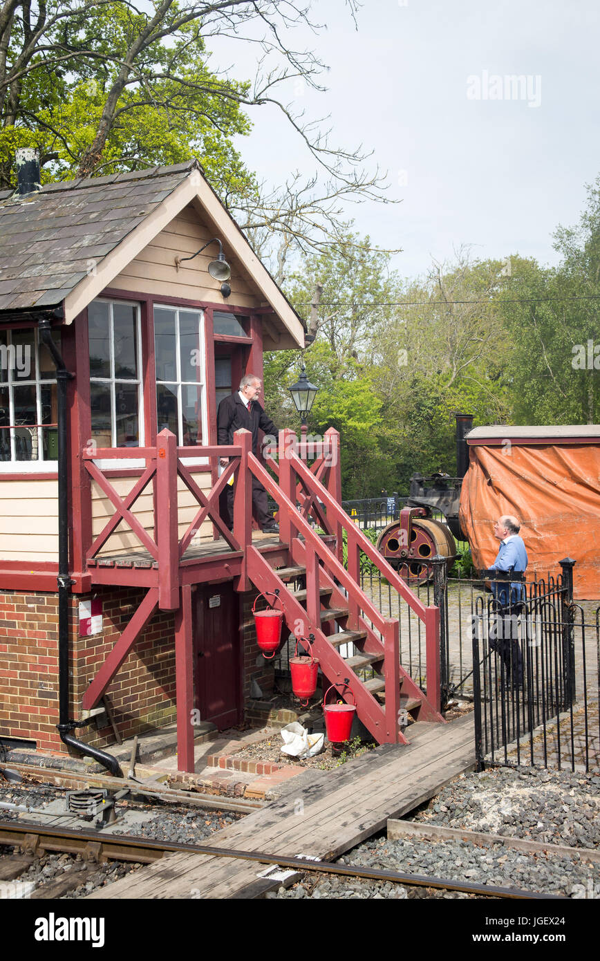 Having a chat with the signalman at Tenterden railway station in Kent UK - Stock Image