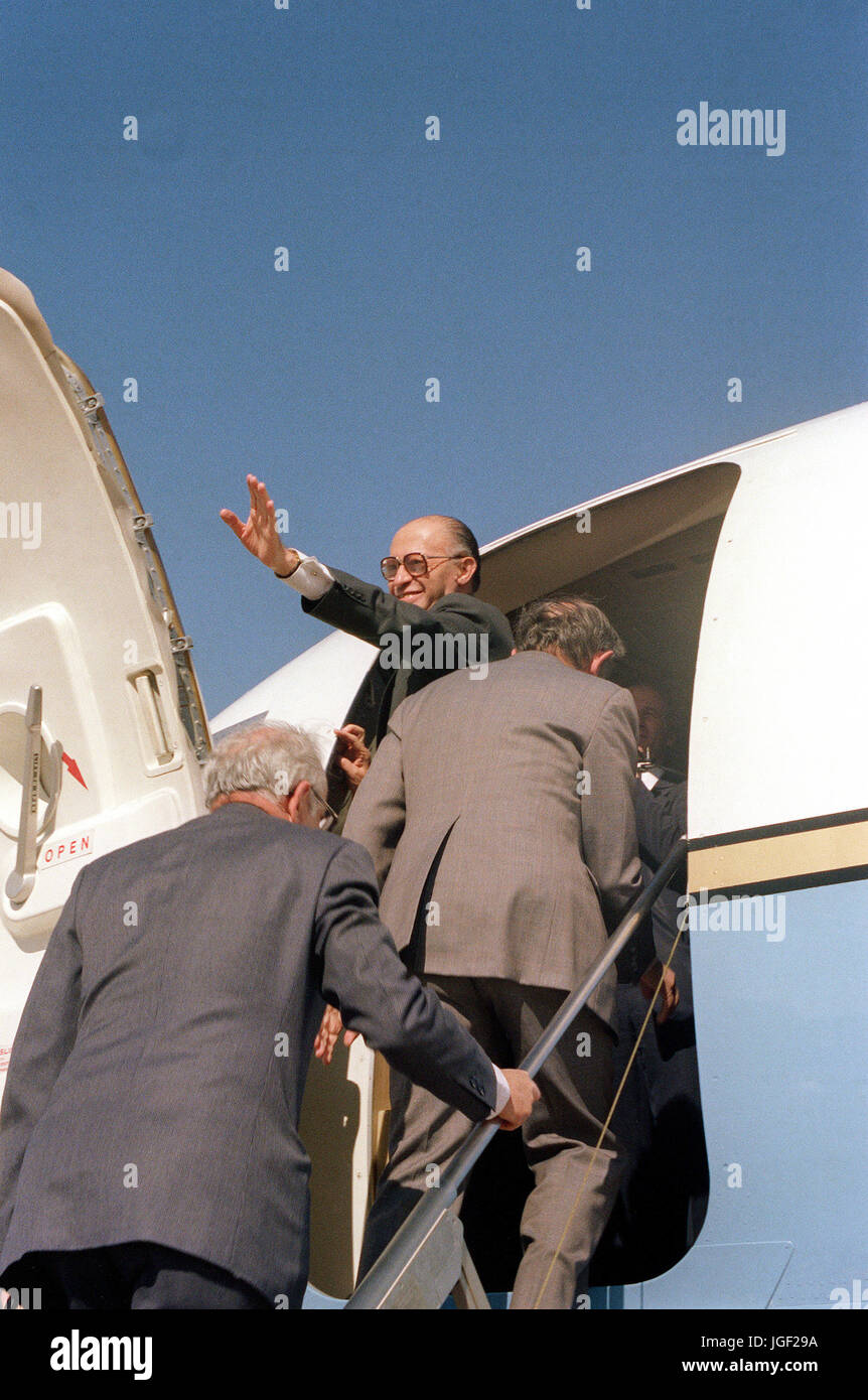 Prime Minister Menachem Begin of Israel waves to the crowd from an aircraft upon his departure from the United States Stock Photo