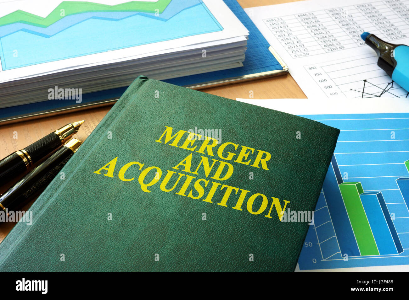 Book with title Merger and Acquisition M&A. - Stock Image