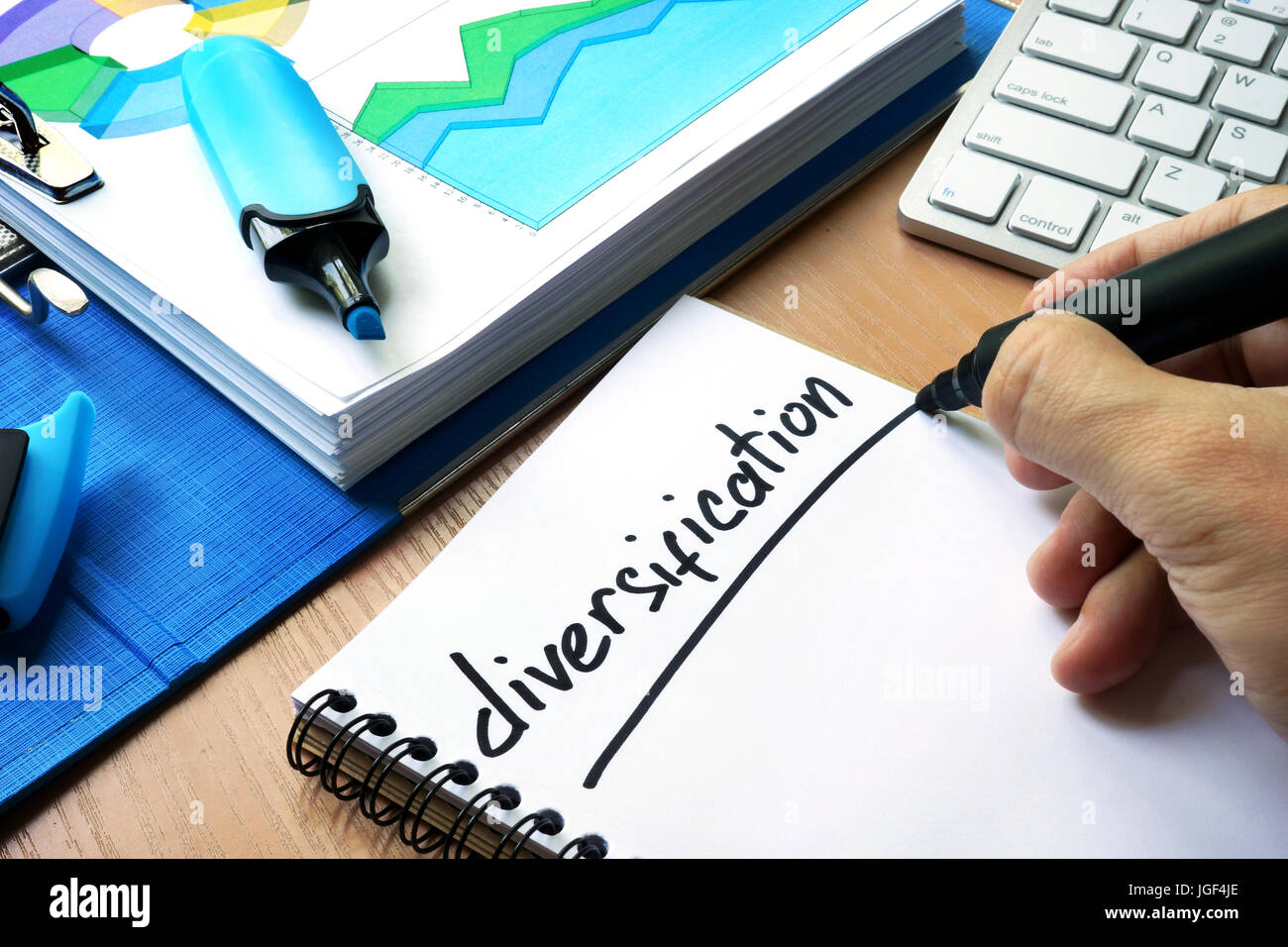 Handwriting sign diversification in a note. Stock Photo