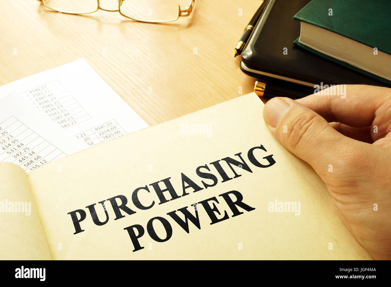 Book with page about purchasing power. Business concept. - Stock Image