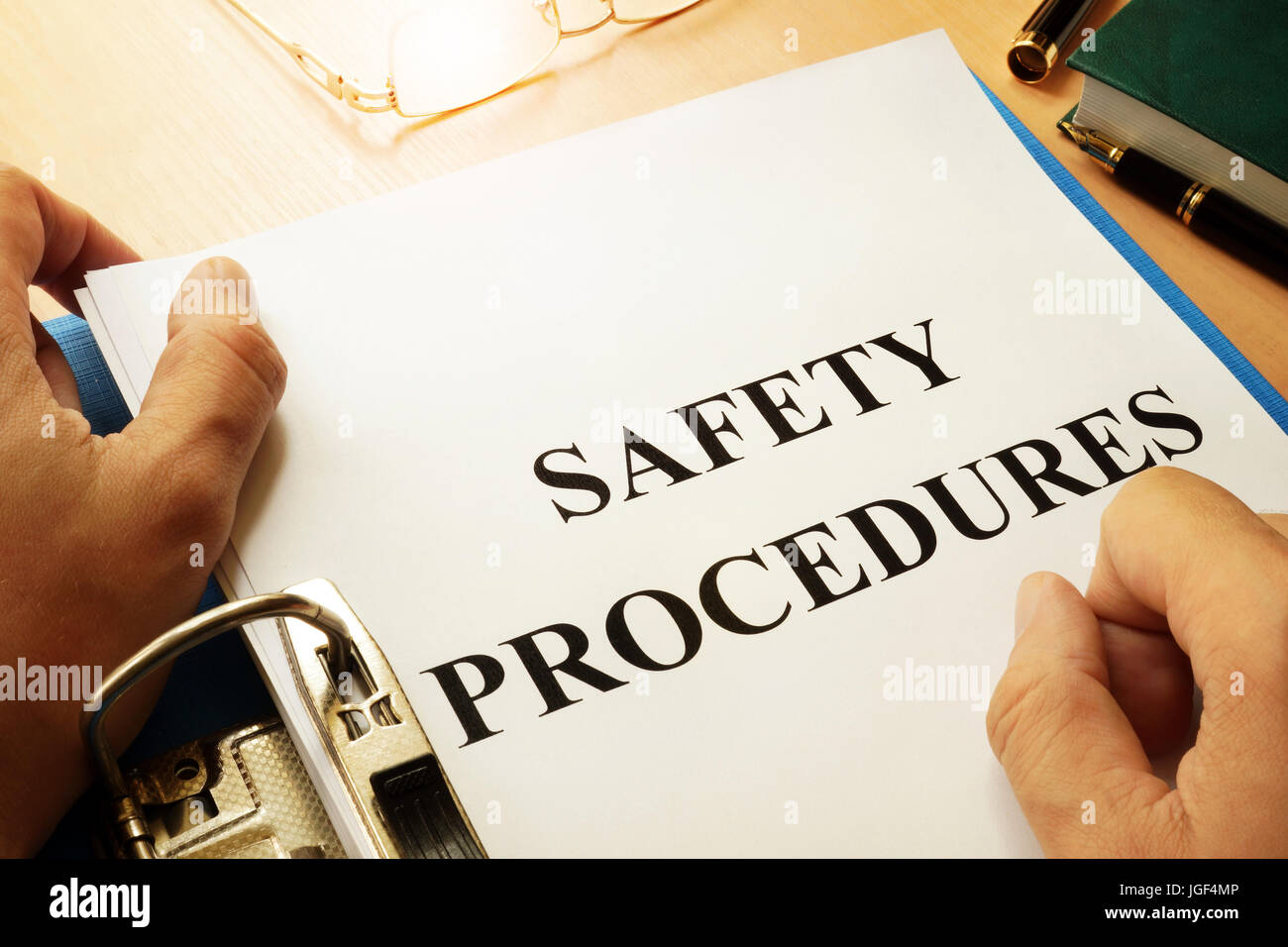 Safety procedures in a blue folder. Work Safety concept. - Stock Image
