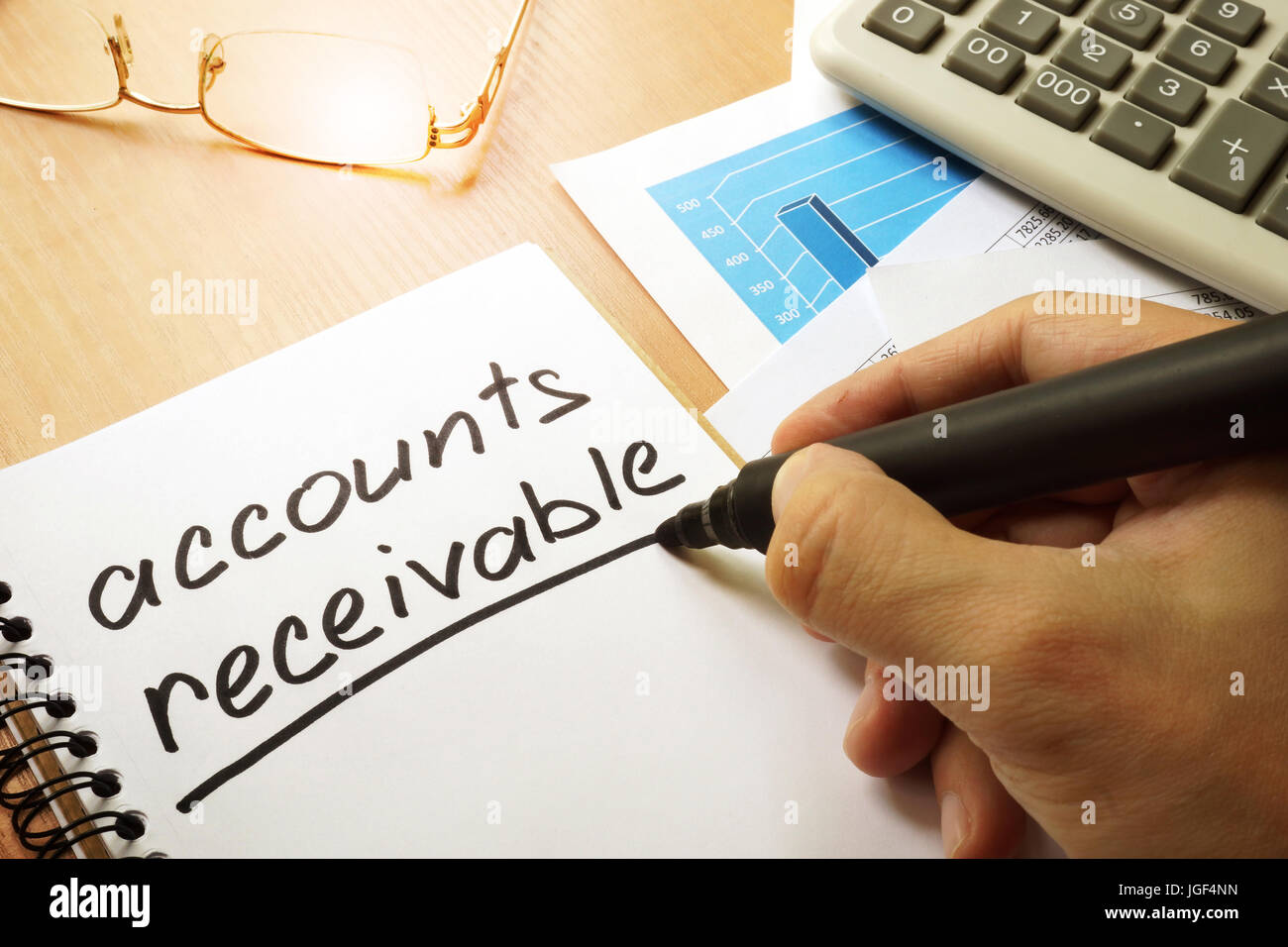 Accounts receivable written by hand in a note. - Stock Image