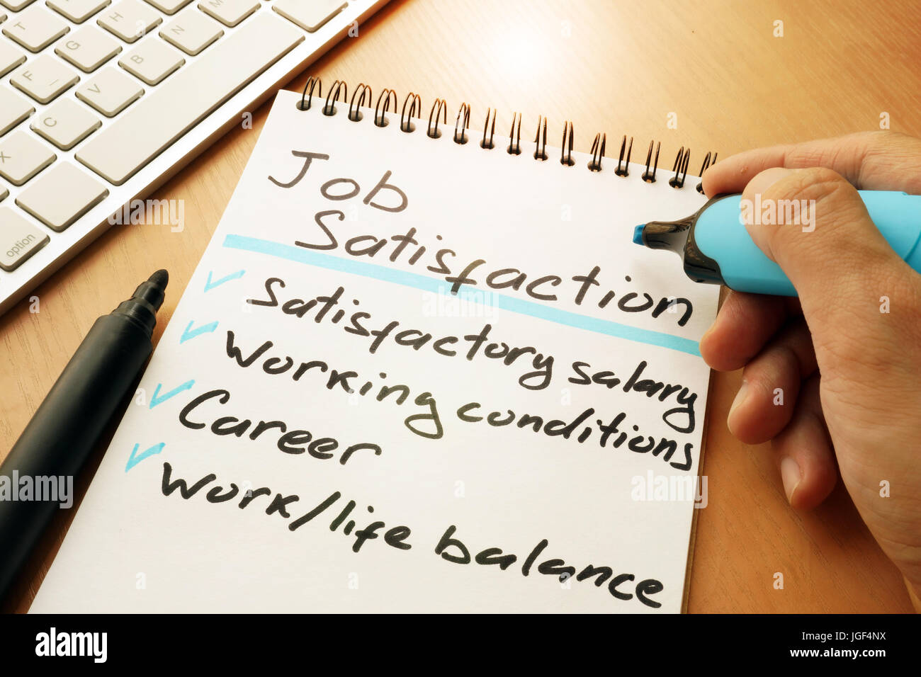 Job satisfaction list written by hand. - Stock Image