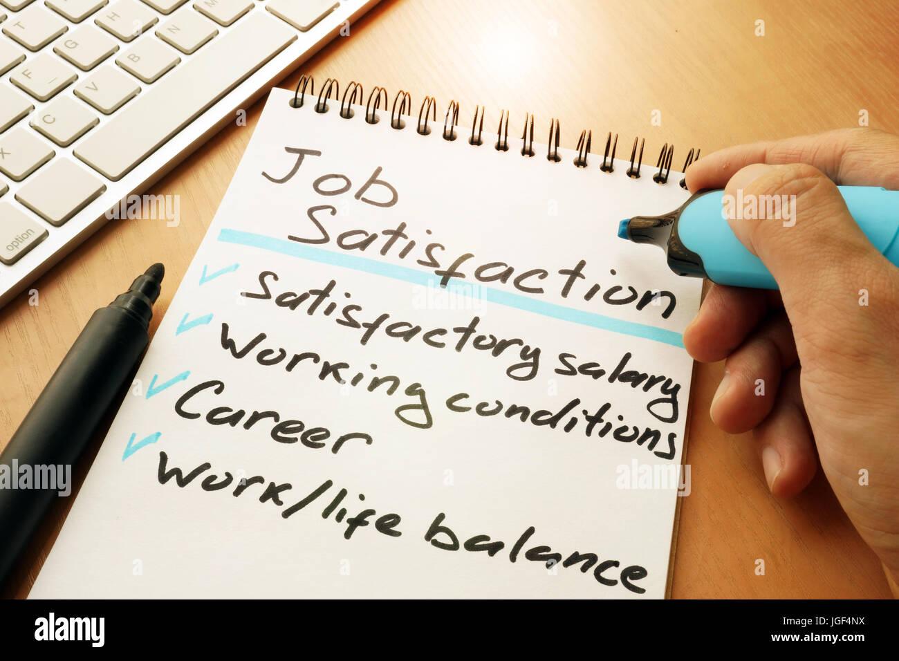 Job satisfaction list written by hand. Stock Photo