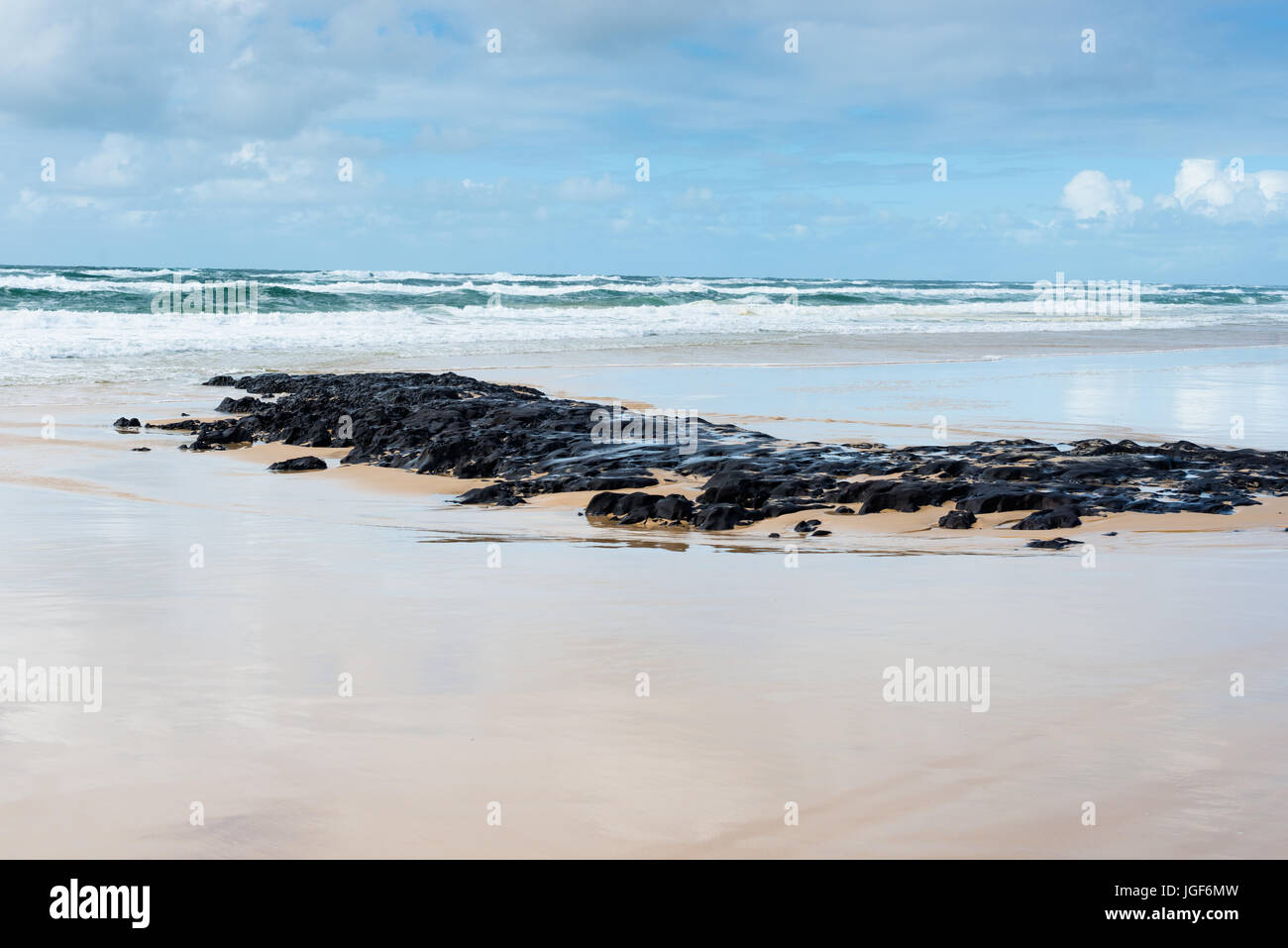Coffee rocks made of sand on the beach at Fraser Island, Queensland, Australia. - Stock Image
