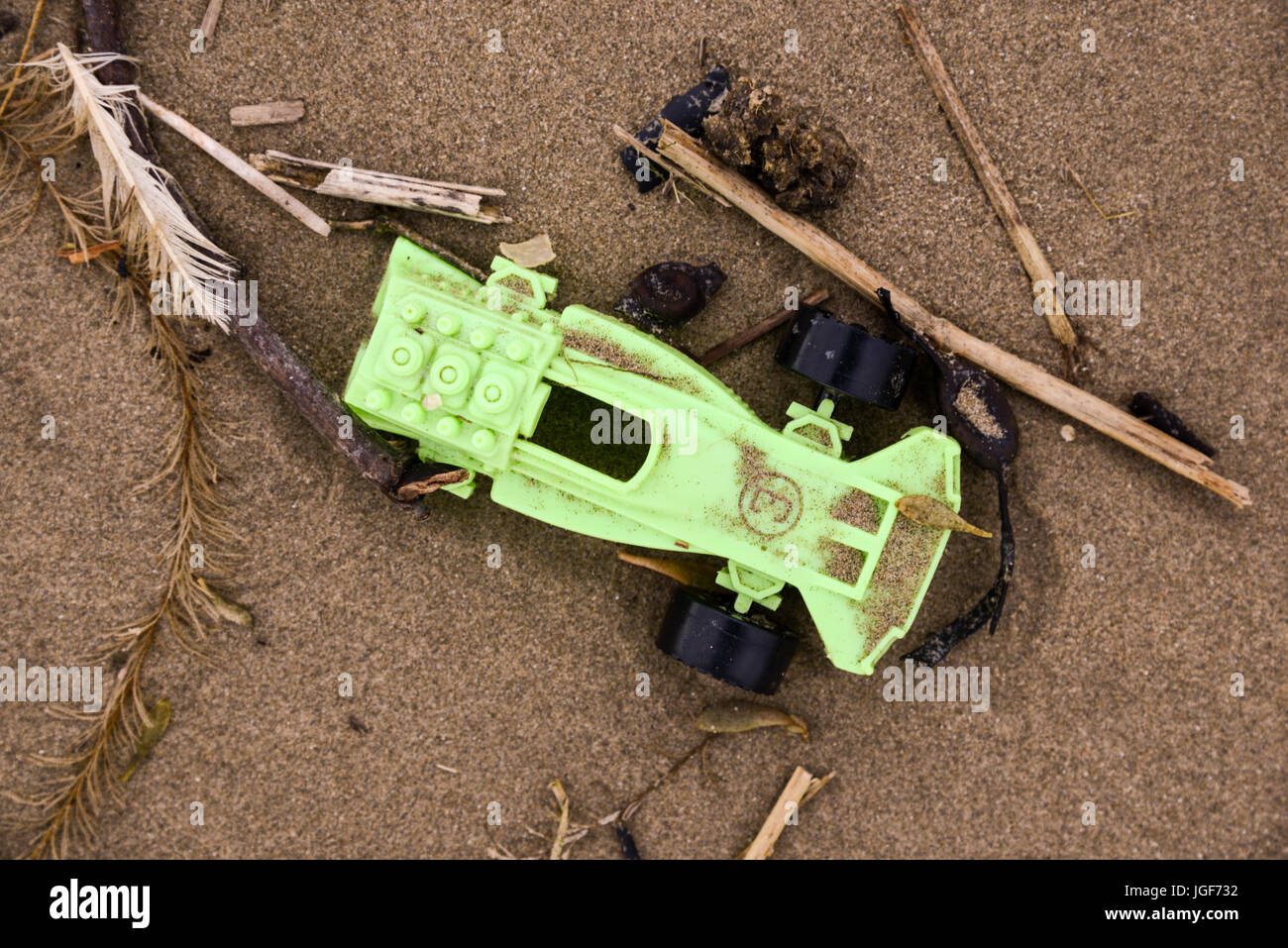 Debris and detritus left on Welsh beach following strong winds and severe weather conditions. UK. Stock Photo