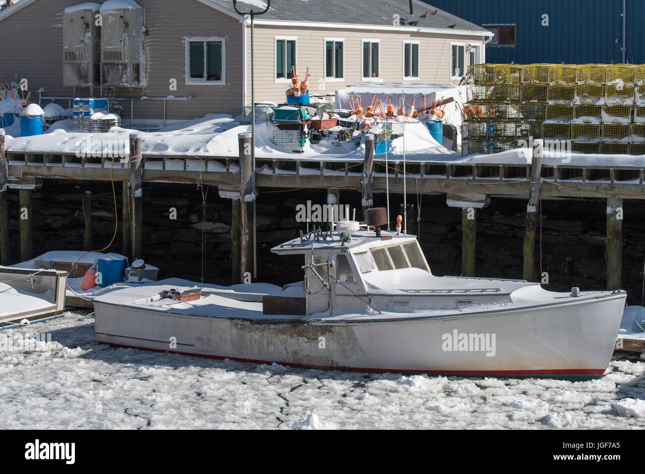 Lobster boats morning after blizzard. Portland Harbor, Maine - Stock Image