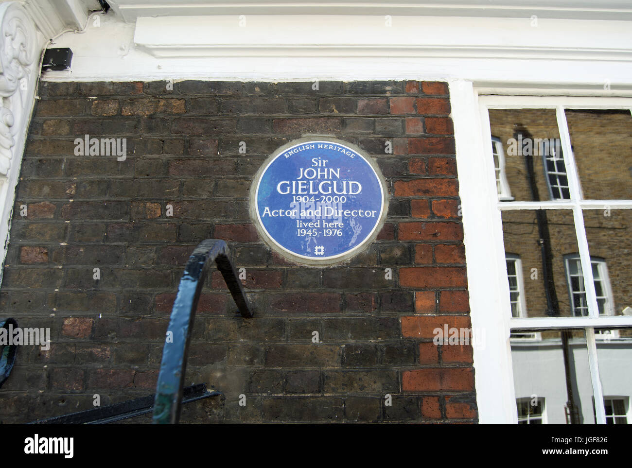 english heritage blue plaque marking a home of actor and director sir john gielgud, westminster, london, england - Stock Image