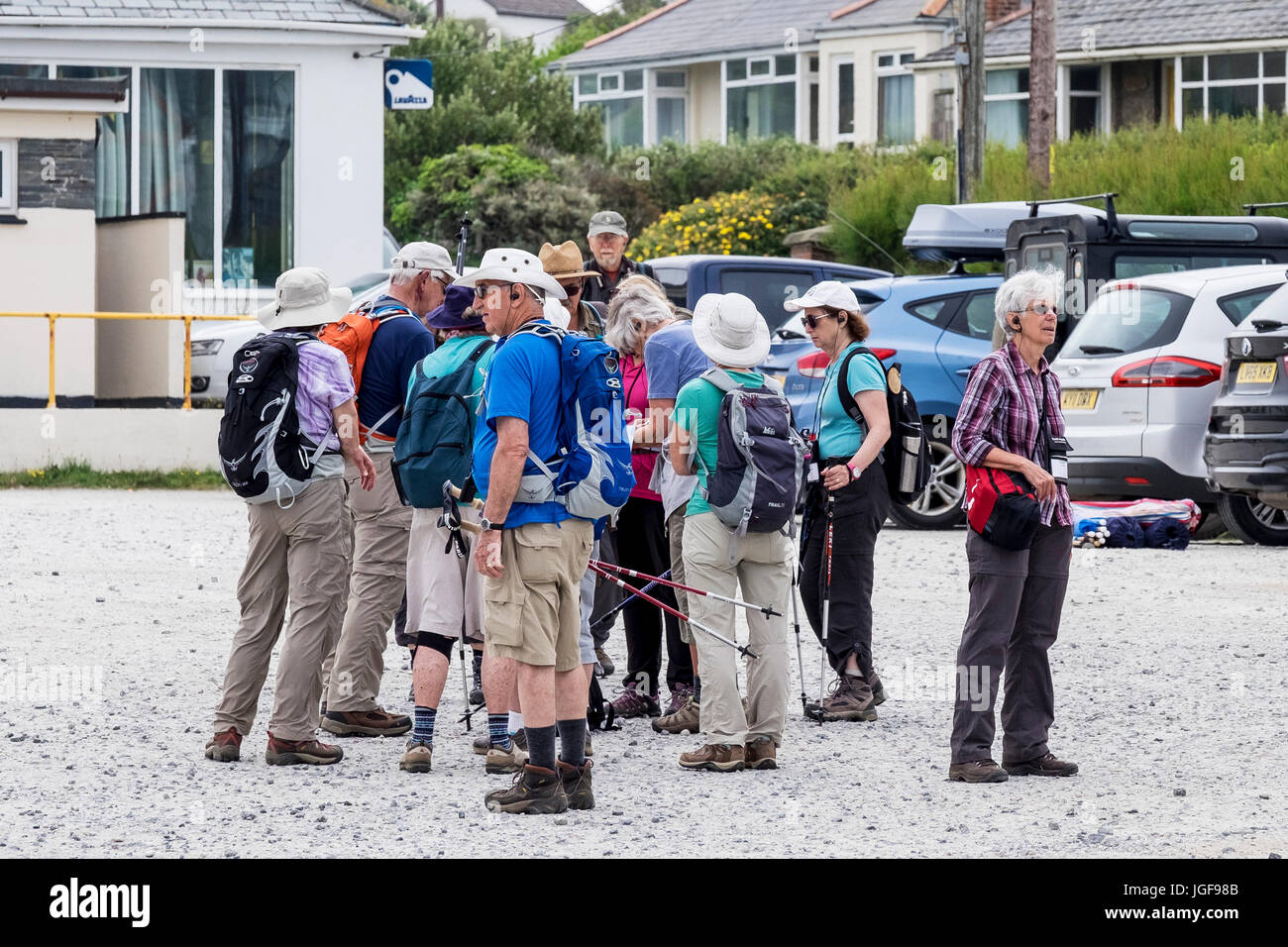 A group of walkers gathering in a car park. - Stock Image