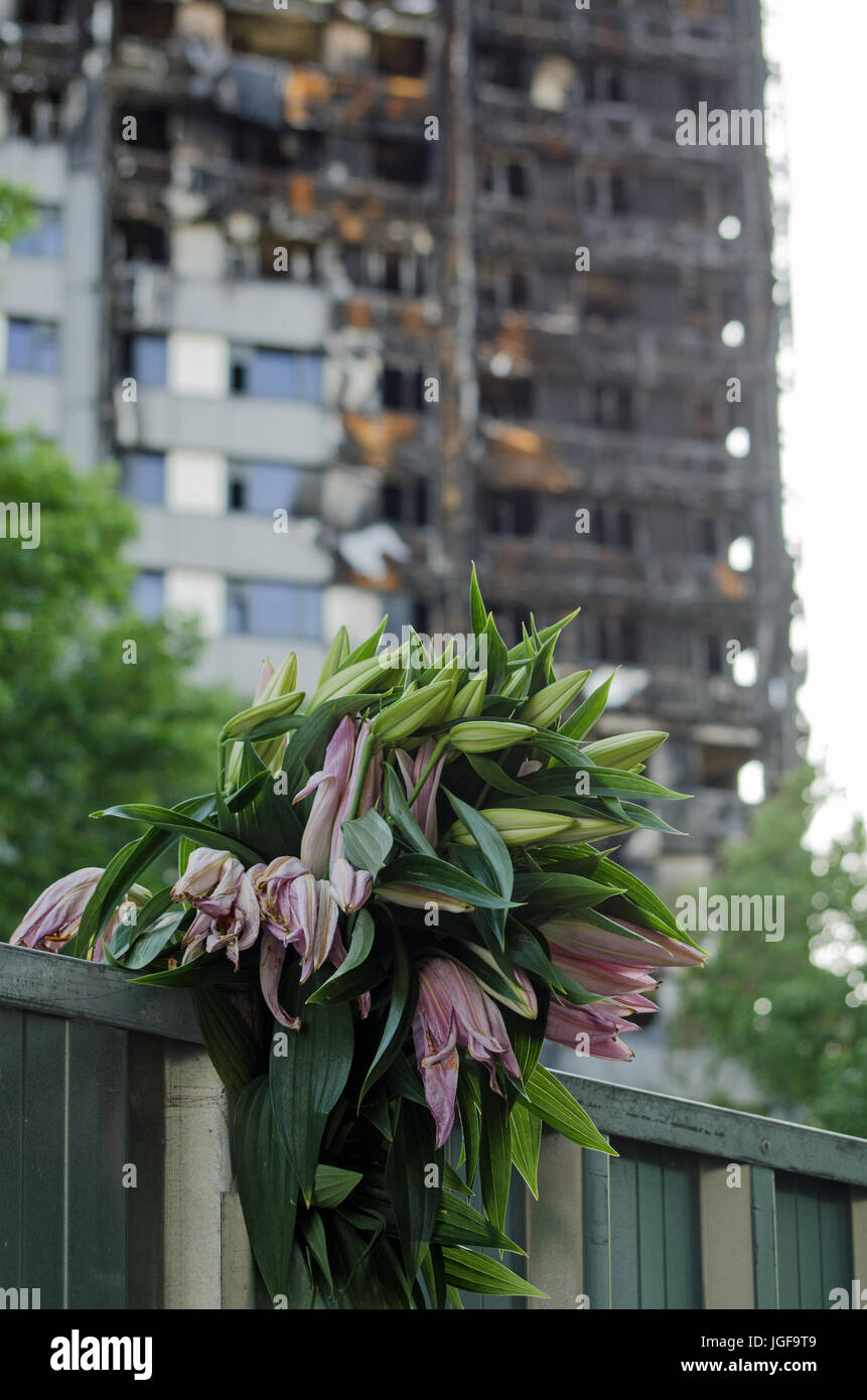A bunch of lillies placed in memory of the 80 feared killed in the Grenfell Tower block fire in Kensington, North - Stock Image