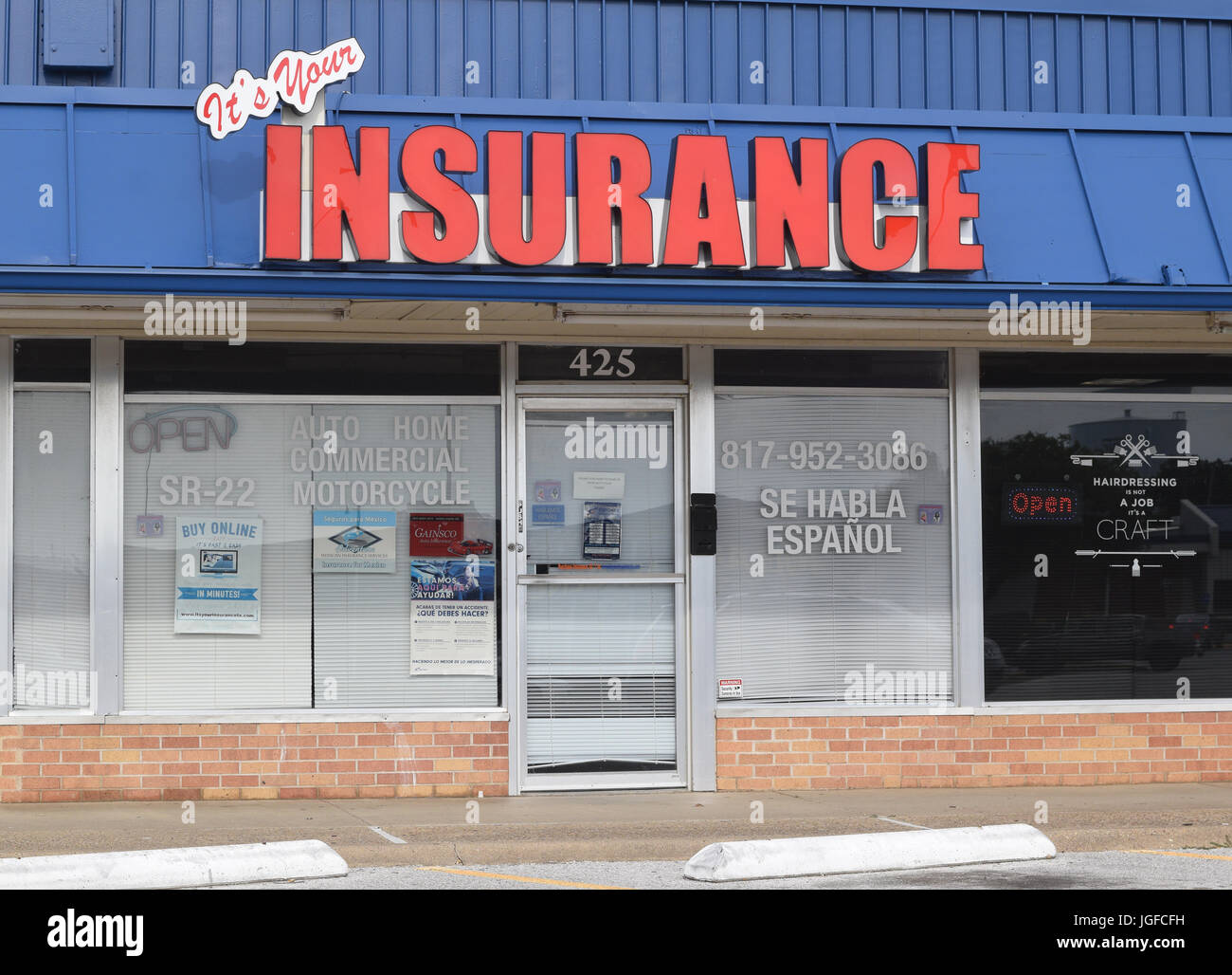 Independent insurance seller in a strip mall - Stock Image