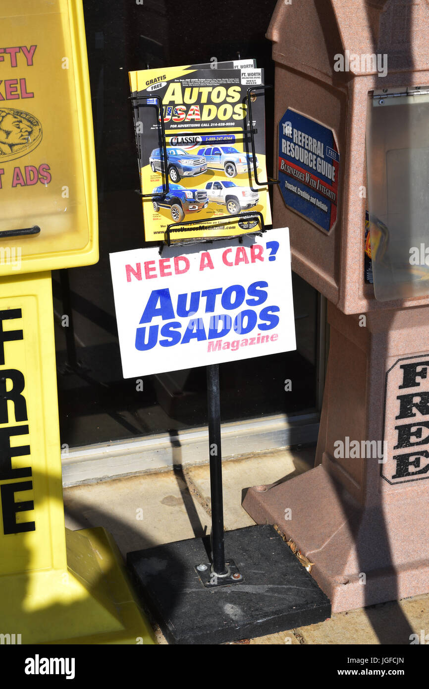 Newspaper boxes offering free advertising papers (used cars) - Stock Image