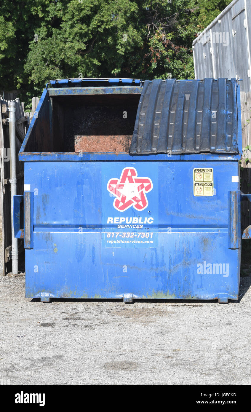 Republic Trash Services blue trash dumpsters - Stock Image