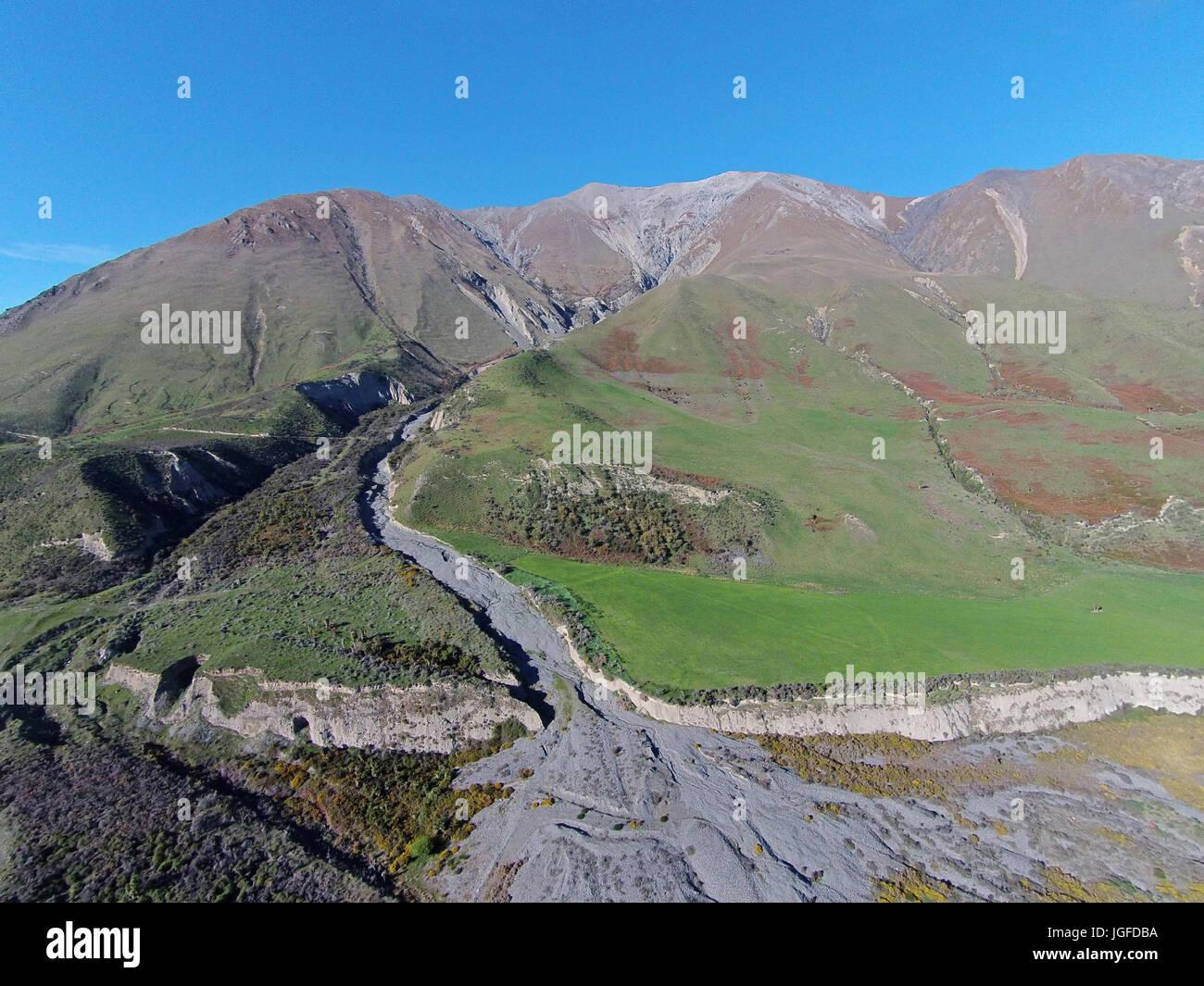 Terrible Gully and Mount Hutt Range, near Rakaia River, Canterbury, South Island, New Zealand - drone aerial Stock Photo