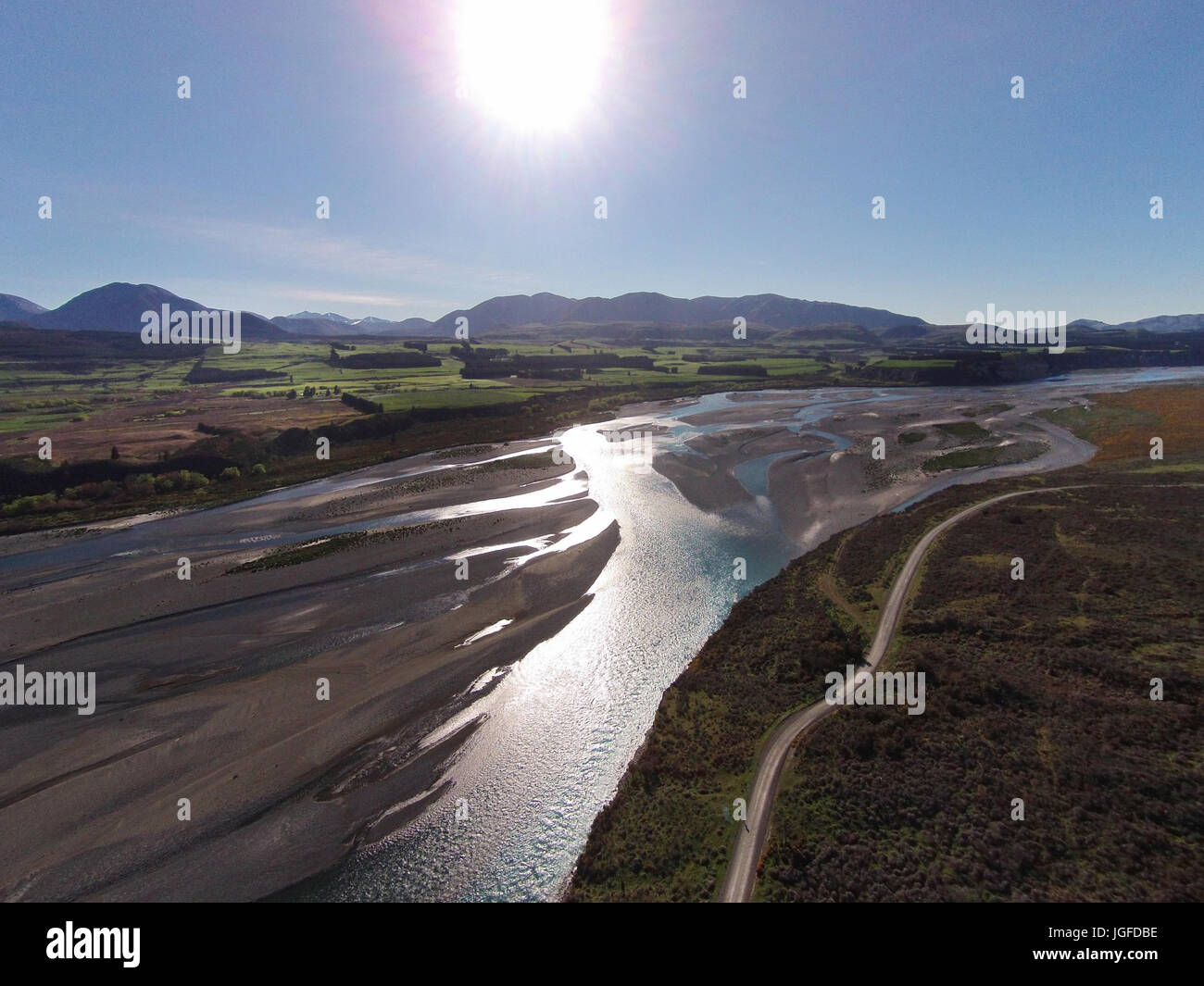 Braided streams of the Rakaia River, and Double Hill Run Road, Canterbury, South Island, New Zealand - drone aerial Stock Photo